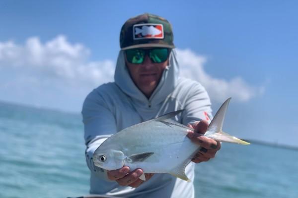 Fisherman Shows Fish To Camera
